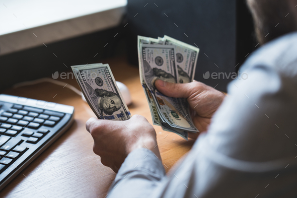 Businessman is counting dollars banknotes, business and financial background - Stock Photo - Images