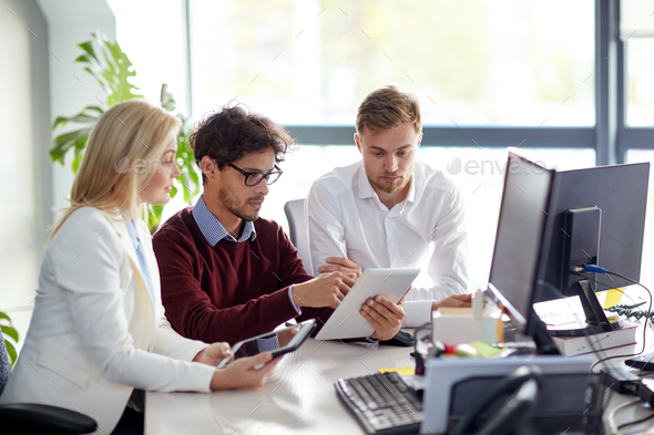 business team with tablet pc at office - Stock Photo - Images