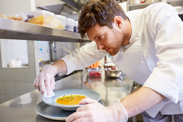 male chef cooking food at restaurant kitchen - Stock Photo - Images