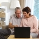 An Elderly Couple Communicates with Laptop Video Call - VideoHive Item for Sale
