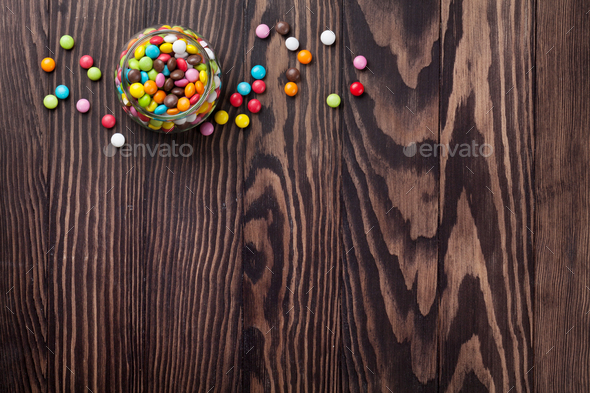 Colorful candies on wooden table - Stock Photo - Images