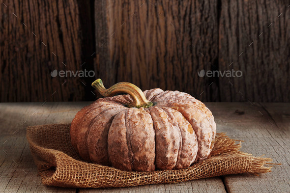 Pumpkin with wood background - Stock Photo - Images
