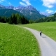 Woman Jogging Outdoors. Italy Dolomites Alps
