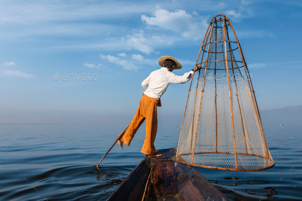 Traditional Burmese fisherman at Inle lake, Myanmar - Stock Photo - Images
