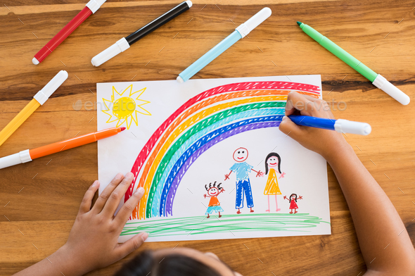 Child drawing happy family - Stock Photo - Images