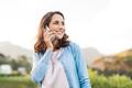 Mature woman talking on phone