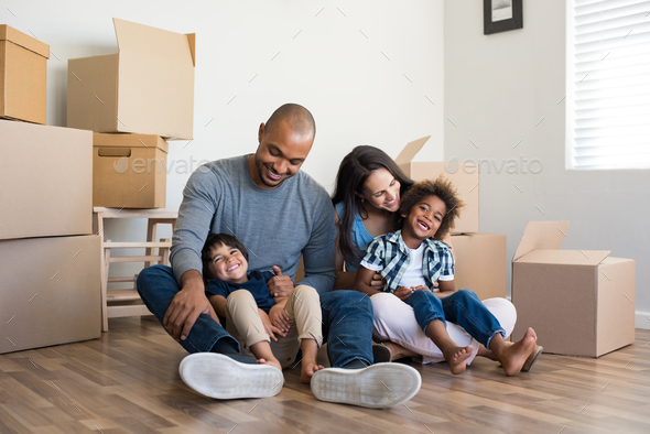 Family moving home - Stock Photo - Images