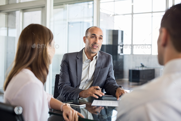 Financial advisor with clients - Stock Photo - Images