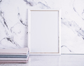 Blank frame and stack of fabrics over marble table - PhotoDune Item for Sale
