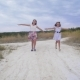 Girls Teenagers Run Along Road Spreading Their Arms Like Wings - VideoHive Item for Sale