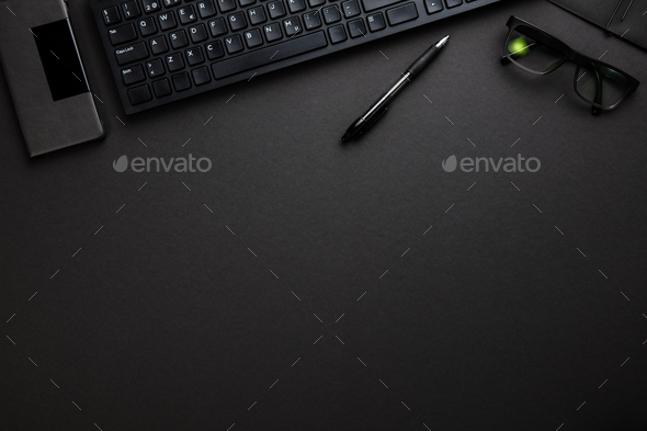Computer Keyboard With Smartphone, Pen And Eyeglasses On Gray De - Stock Photo - Images