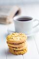 Sweet pistachio cookies and coffee mug.