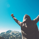Download Winning and success. Victorious female person on mountain top. from PhotoDune
