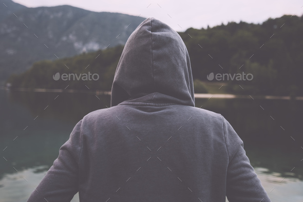 Gloomy sad woman standing by the lake - Stock Photo - Images