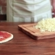 Woman Make Pizza, Sprinkles Cheese on the Dough - VideoHive Item for Sale