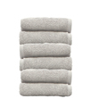 Stack of white plush hotel towels isolated on white background