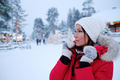 Happy woman in a snow landscape