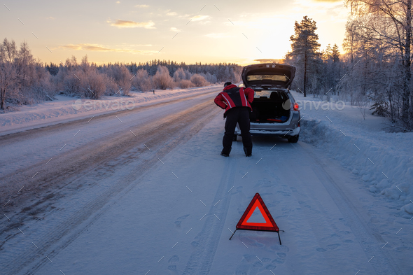 Broken on a snowy winter road - Stock Photo - Images