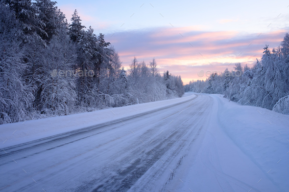 Beautiful snowy road in winter landscape - Stock Photo - Images