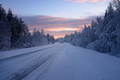 Beautiful snowy road in winter landscape