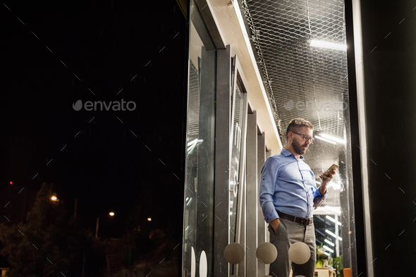Businessman in the office at night working late. - Stock Photo - Images