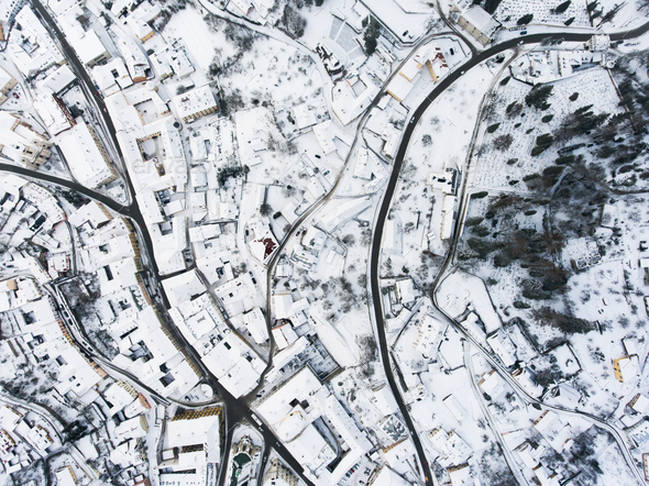 Aerial view of small town with hills in winter. - Stock Photo - Images