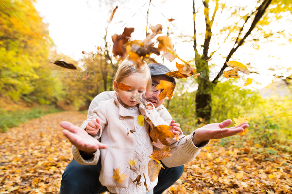 Young father with his daughter in autumn forest. - Stock Photo - Images