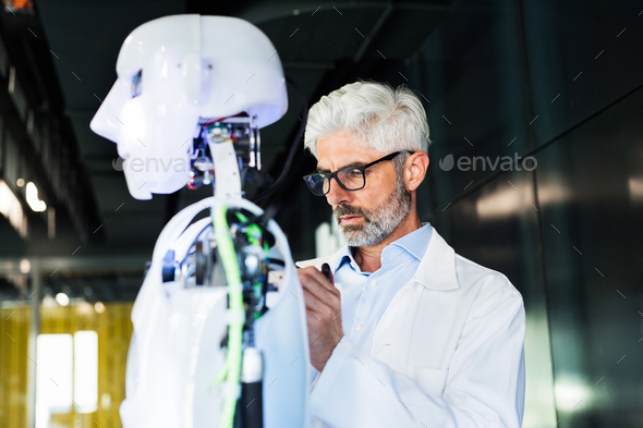 Businessman or a scientist with a robot. - Stock Photo - Images