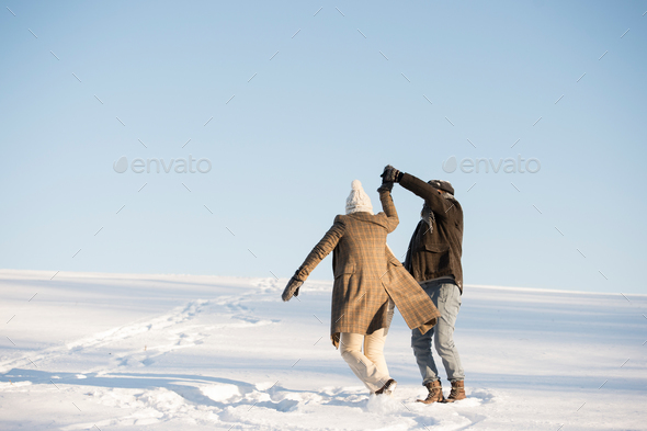 Beautiful senior couple on a walk, winter day. - Stock Photo - Images