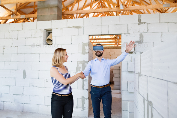 Young married couple at the construction site. - Stock Photo - Images