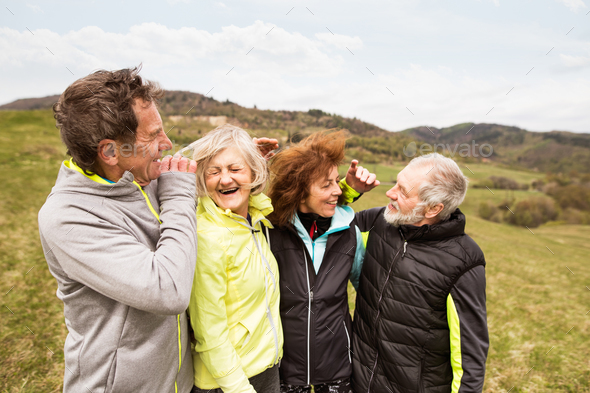 Group of senior runners outdoors, resting and hugging. - Stock Photo - Images
