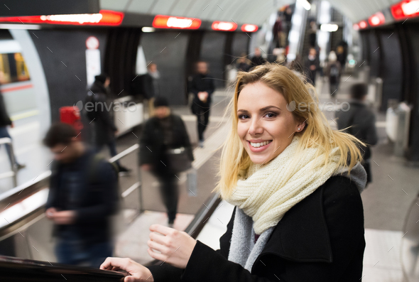 Young woman standing at the escalator in Vienna subway - Stock Photo - Images