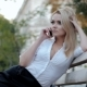 Young Beautiful Blonde Businesswoman Talking By Mobile Phone While Sitting on Benchin the City - VideoHive Item for Sale