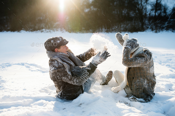 Beautiful senior couple in sunny winter nature. - Stock Photo - Images