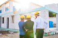 Architects and worker at the construction site. - PhotoDune Item for Sale