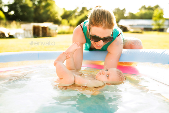Little baby boy with his mother in the swimming pool. - Stock Photo - Images