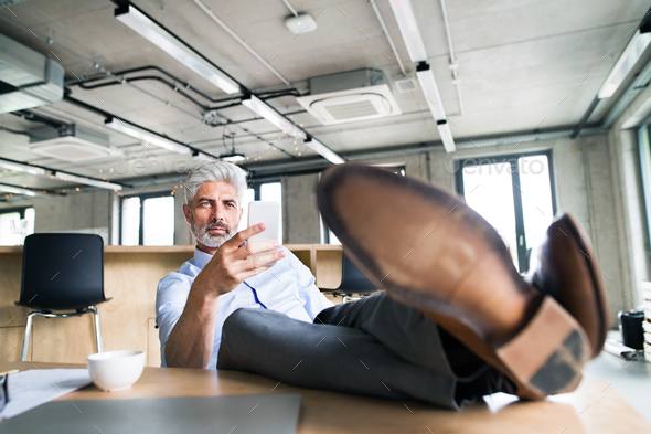 Thoughtful mature businessman in the office. - Stock Photo - Images