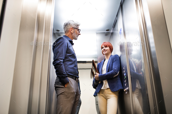 Business people in the elevator in modern office building. - Stock Photo - Images