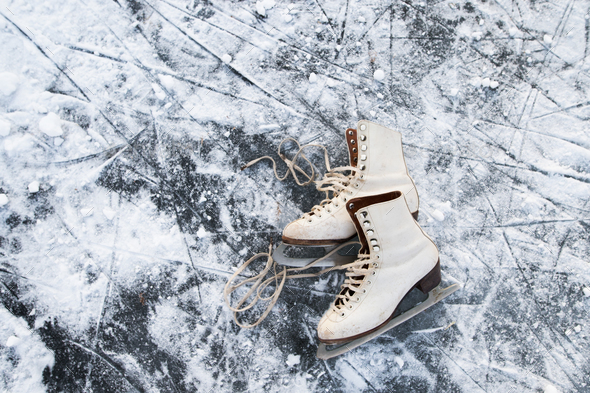Old womans ice skates on the ice. - Stock Photo - Images