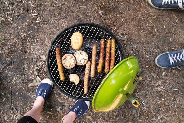 Barbecue grill with sausages, cheese and vegetables. - Stock Photo - Images