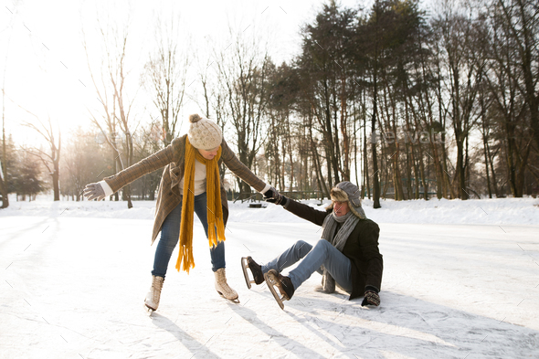 Senior couple in sunny winter nature ice skating. - Stock Photo - Images