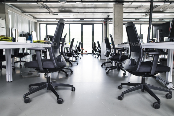 The interior of big empty modern office after work. - Stock Photo - Images