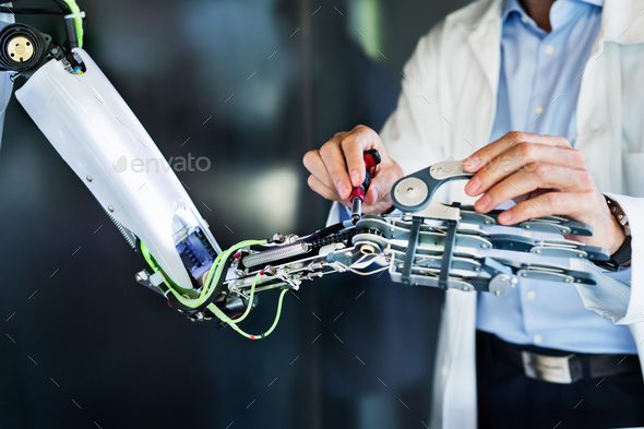 Unrecognizable scientist with a robot. - Stock Photo - Images