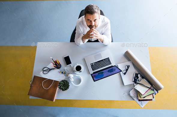 Businessman at the desk with laptop in his office. - Stock Photo - Images