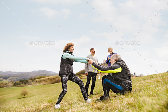 Group of active senior runners outdoors, resting. - Stock Photo - Images