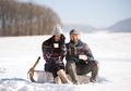 Young woman and man with cup of coffee in winter nature. - PhotoDune Item for Sale