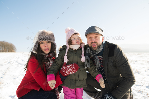 Father and mother with their daughter, winter day. - Stock Photo - Images
