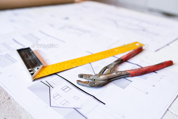 Hammer, nails on wooden boards outside on construction site - Stock Photo - Images