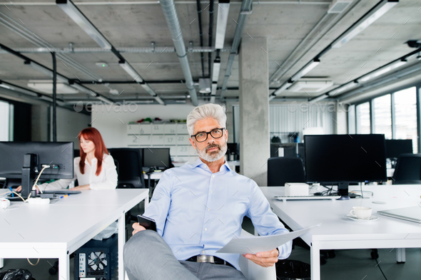 Two business people in the office working. - Stock Photo - Images