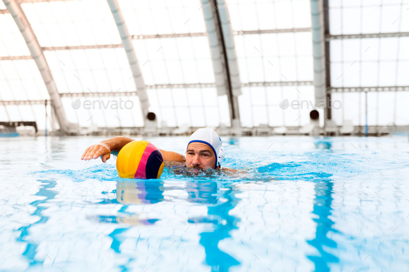 Water polo player in a swimming pool. - Stock Photo - Images